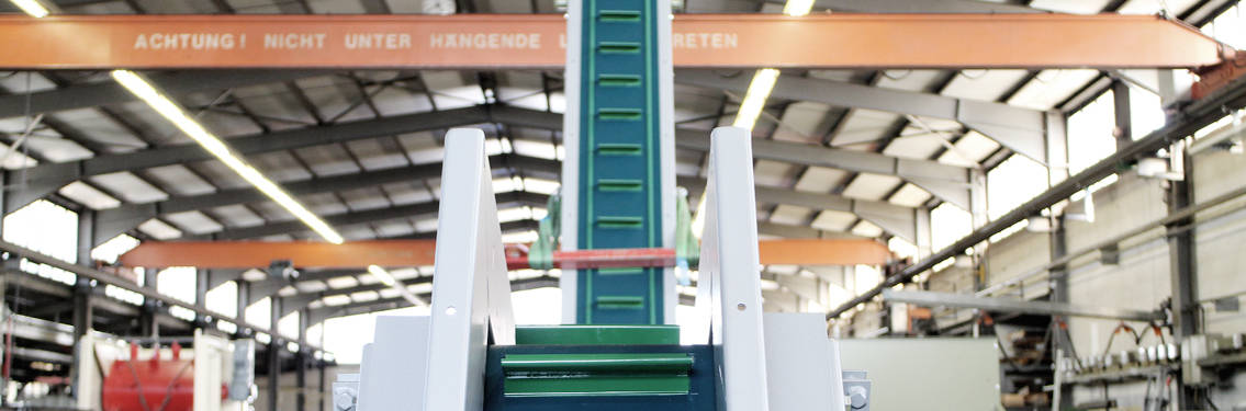 Förderband Huber Technik Steilförderer blau-grüner Gurt weißes Fördersystem